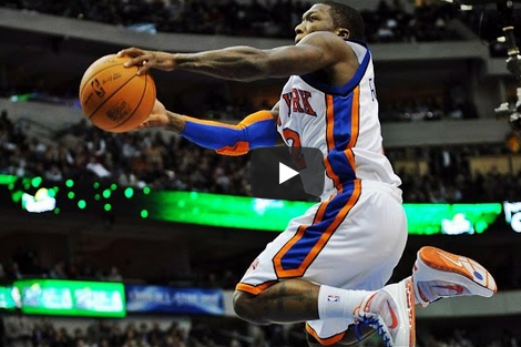 Knicks player Nate Robinson in air during a lay up.
